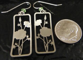 back of yellow flower blossom Sienna Sky dangle earrings with dime