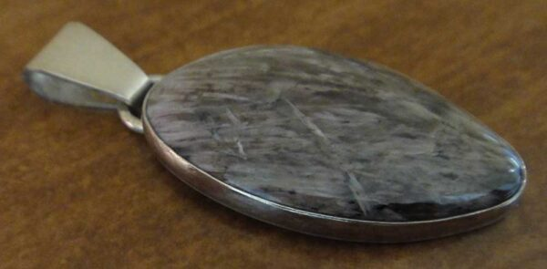 Handmade yuksporite and sterling silver pendant by Dale Repp in Lone Tree, Iowa