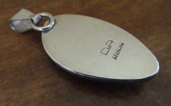 Handmade yuksporite and sterling silver pendant back view